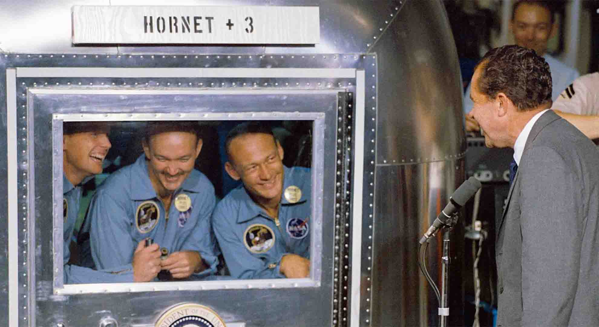 Richard Nixon welcoming the Apollo 11 crew after an outer space mission