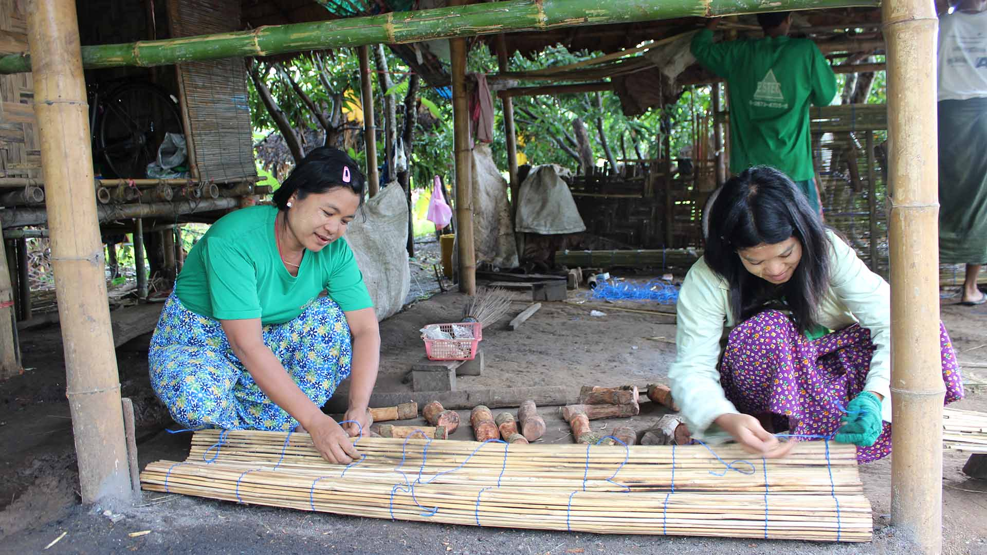 Local artisans making bamboo blinds for a modular building